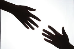 Helping hands. Close up helping hands silhouette stock photography