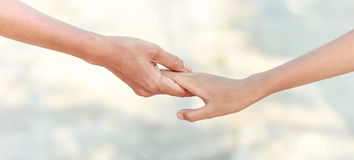 Helping hands - family support. Helping hands concept - man hold child hand stock image