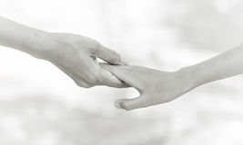 Helping hands - family support. Helping hands concept - man hold child hand royalty free stock photography
