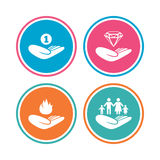Helping hands icons. Protection and insurance. Helping hands icons. Financial money savings, family life insurance symbols. Diamond brilliant sign. Fire Stock Photo