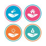 Helping hands icons. Protection and insurance. Stock Images