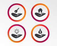 Helping hands icons. Protection and insurance. Helping hands icons. Financial money savings insurance symbol. Home house or real estate and lamp, key signs Stock Photos