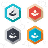 Helping hands icons. Protection and insurance. Hexagon buttons. Helping hands icons. Financial money savings insurance symbol. Home house or real estate and lamp Royalty Free Stock Photos