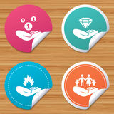 Helping hands icons. Protection and insurance. Round stickers or website banners. Helping hands icons. Financial money savings, family life insurance symbols Stock Photography