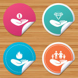 Helping hands icons. Protection and insurance. Round stickers or website banners. Helping hands icons. Financial money savings, family life insurance symbols Royalty Free Stock Images