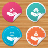 Helping hands icons. Protection and insurance. Round stickers or website banners. Helping hands icons. Financial money savings insurance symbol. Home house or Royalty Free Stock Photography