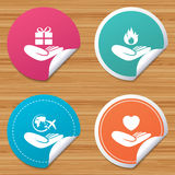 Helping hands icons. Protection and insurance. Round stickers or website banners. Helping hands icons. Health and travel trip insurance symbols. Gift present Stock Images