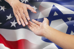 Helping hands with israel and american flags Stock Photos