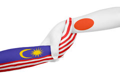 Helping hands of Malaysia and Japan. With flags painted on child`s hands in isolated white background royalty free stock photos