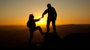 Helping hands Silhouetted Royalty Free Stock Photography