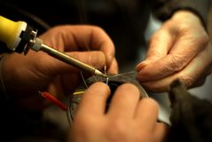Helping Hands. While soldering a wire Stock Image