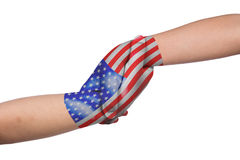Helping hands of two children with United States of America flag. Painted in isolated white background Stock Photography