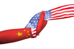 Helping hands of United States of America and China. With flags painted on child`s hands in isolated white background Royalty Free Stock Photography