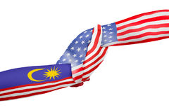 Helping hands of United States of America and Malaysia. With flags painted on child`s hands in isolated white background Stock Image