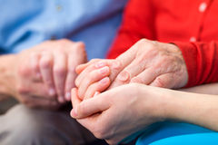 Helping hands. Young carer giving helping hands for elderly woman stock images