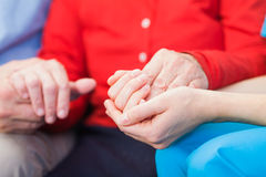 Helping hands. Young carer giving helping hands for elderly woman royalty free stock images