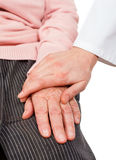 Helping hands. Young doctor giving helping hands for elderly woman Royalty Free Stock Photos