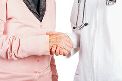 Helping hands. Young doctor giving helping hands for elderly woman royalty free stock image