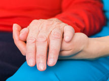 Helping hands. Young doctor giving helping hands for elderly woman Stock Photo