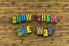 Show them the way helping. Helping help volunteer volunteering people show them the way how give back teamwork success successful positive attitude good role stock photos