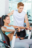 Helping her with exercising. Royalty Free Stock Photos
