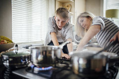 Helping Mum with the Cooking stock images