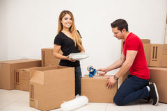 Helping my boyfriend pack Stock Photography