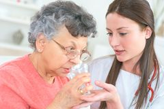 Helping old lady to take medication royalty free stock images