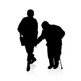 Helping an old man - vector silhouettes Royalty Free Stock Image