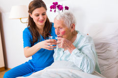 Helping out elderly patient stock photo