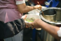 Helping People With Hunger With Kindness : the concept of life problems, hunger in society : concept of charity food for the poor. Hand-feeding to the needy stock images