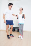 Helping personal trainer Royalty Free Stock Photo