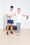 Helping personal trainer Stock Photos