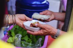 Helping the poor in society by donating food : The concept of hunger.  stock photography