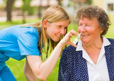 Helping the sick elderly Stock Image