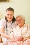 Helping a sick elderly woman Stock Photos