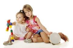 Helping Sister Play Royalty Free Stock Photos