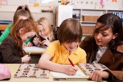 The helping teacher royalty free stock photos