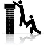 Helping to lift someone over a wall Royalty Free Stock Image