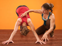 Helping With Yoga Stock Photography