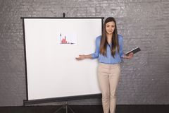 Helpless business woman trying to explain a graph stock images