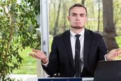 Helpless businessman Royalty Free Stock Photo