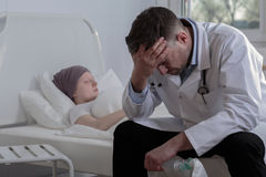Helpless doctor and cancer child Royalty Free Stock Photo