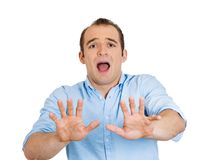 Helpless man raising hands Stock Photos