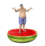 Helpless Obese Man Standing Watermelon Weight Gain. Obese man standing on top of a watermelon cut in half Royalty Free Stock Photos