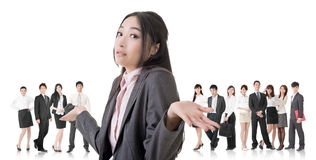Helpless sign. Attractive Asian business women give you a helpless sign and stand in front of her team Stock Photography