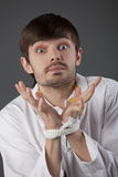 Helpless tied doctor. Nothing can do - metaphor, doctor hands tied up over grey background Stock Photo