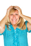 Helpless Woman Holding Head. Helplessly frustrated European female holding head Stock Photography