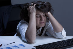 Helpless woman during overtime. Horizontal view of helpless woman during overtime Royalty Free Stock Image