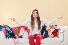 Helpless woman sitting on sofa in messy room home. Stock Photography